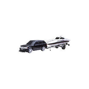 Photo of New Bright 1:10 R/C Range Rover With Boat Toy