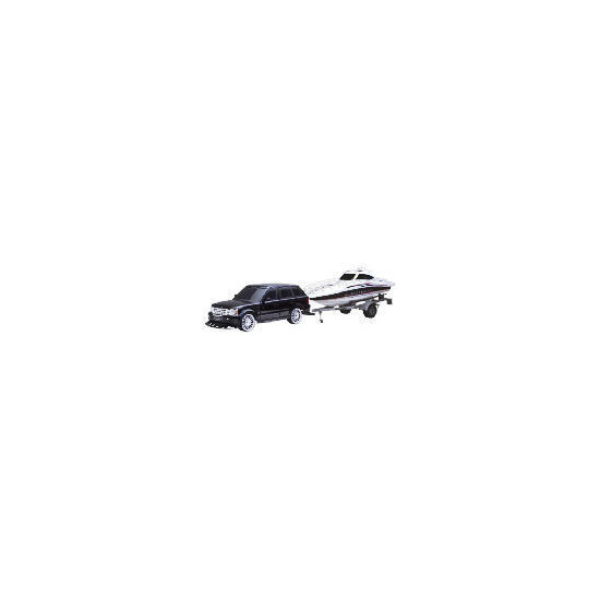 New Bright 1:10 R/C Range Rover With Boat