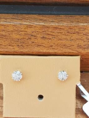 User supplied image of 9K White Gold Natural White Diamond (Rnd and Bgt) Starburst Stud Earrings (with Push Back) 0.10 Ct.
