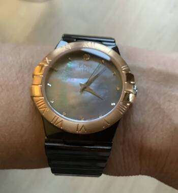 User supplied image of EON 1962 Swiss Movement Water Resistance Diamond Studded Watch with Grey Mother of Pearl Dial, Blue Sapphire and Black Ceramic Strap in Dual Tone Plating