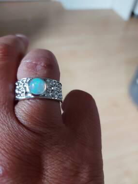 User supplied image of Ethiopian Welo Opal Band Ring in Platinum Overlay Sterling Silver 1.00 Ct.