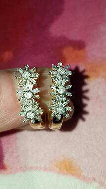 User supplied image of 9K Y Gold Diamond (Rnd and Bgt) Floral Earrings 0.500 Ct.