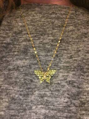 User supplied image of Hebei Peridot (Mrq) Butterfly Pendant in 14K Gold Overlay Sterling Silver 4.500 Ct.
