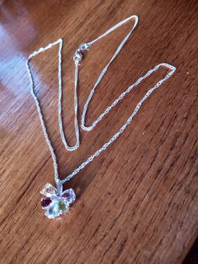 User supplied image of Sky Blue Topaz, Hebei Peridot and Multi Gemstone Floral Pendant in Sterling Silver 2.34 Ct.