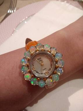 User supplied image of EON 1962 Japanese Movement Ethiopian Welo Opal (Rnd) MOP Dial Watch in Dual Tone with Orange Colour Leather Strap and Stud Earrings (with Push Back) in Yellow Gold Overlay Sterling Silver 6.540 Ct.