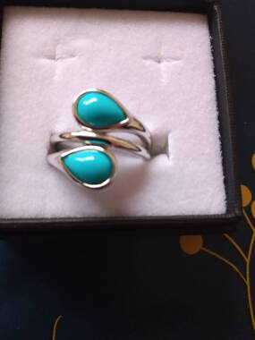 User supplied image of LucyQ AAA Arizona Sleeping Beuaty Turquoise Bypass Ring in Rhodium Overlay Sterling Silver 2.020  Ct, Silver wt. 5.43 Gms